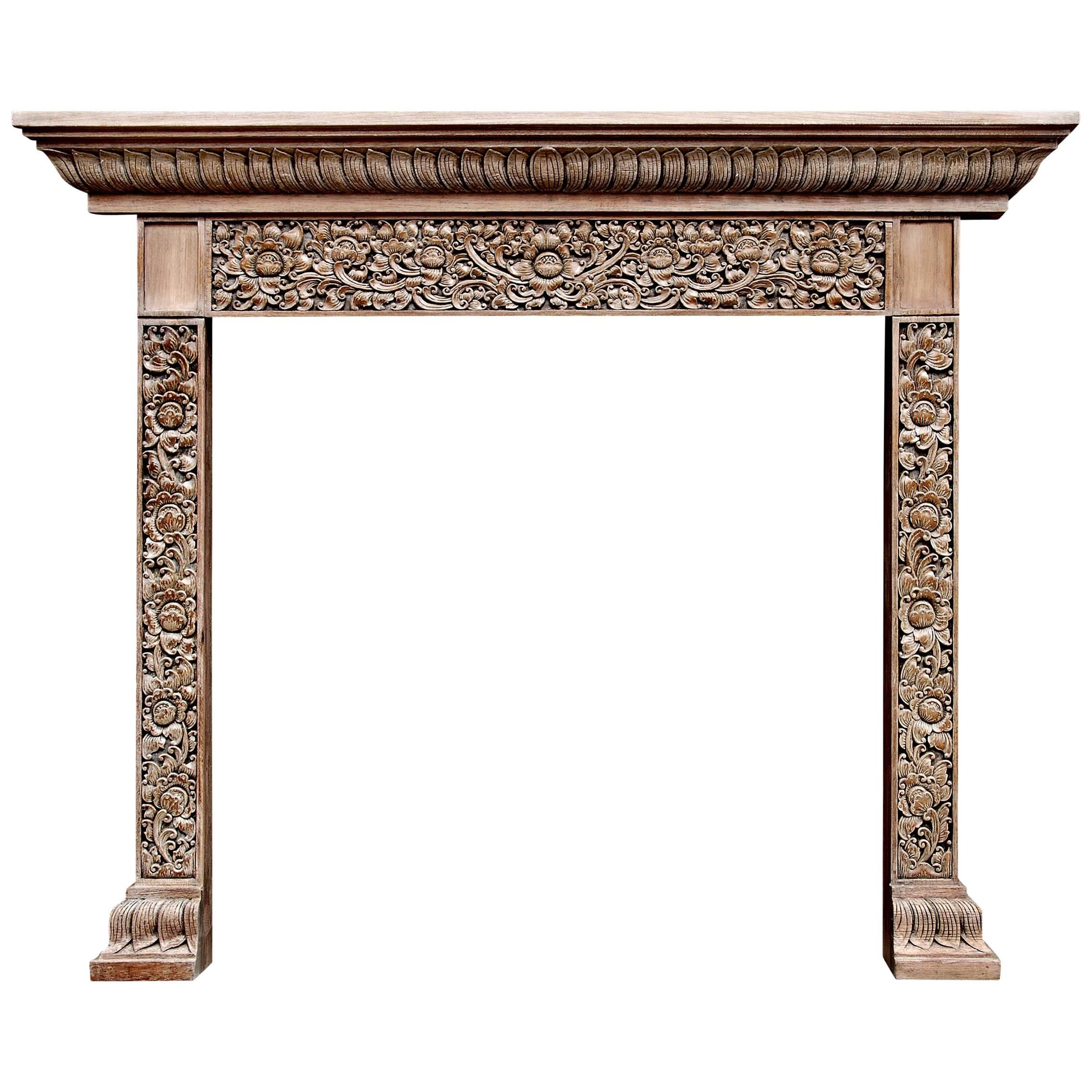 Heavily Carved Hardwood Fireplace With An Oriental Influence