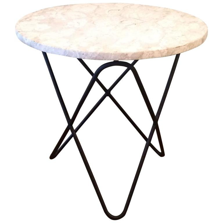 Travertine and wrought iron butterfly base side table at for Wrought iron side table base
