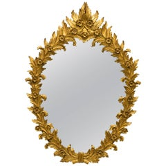 1960s Italian Carved Wood Floral Gilt Mirror. Pair available.