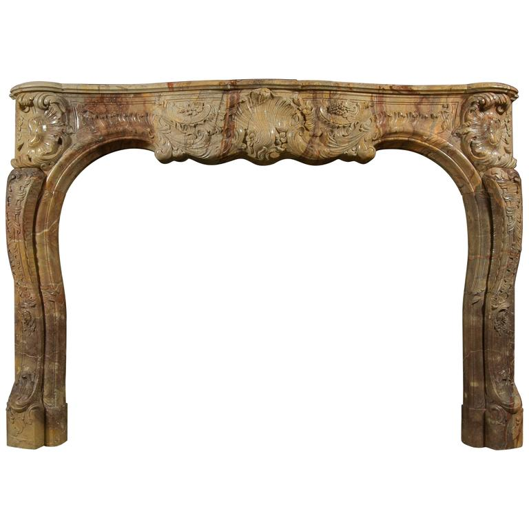 Superb Quality French Louis XV Style Carved Sarrancolin Marble Fireplace For Sale