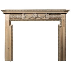 Carved Pine Fireplace with Lion's Mask and Drapery