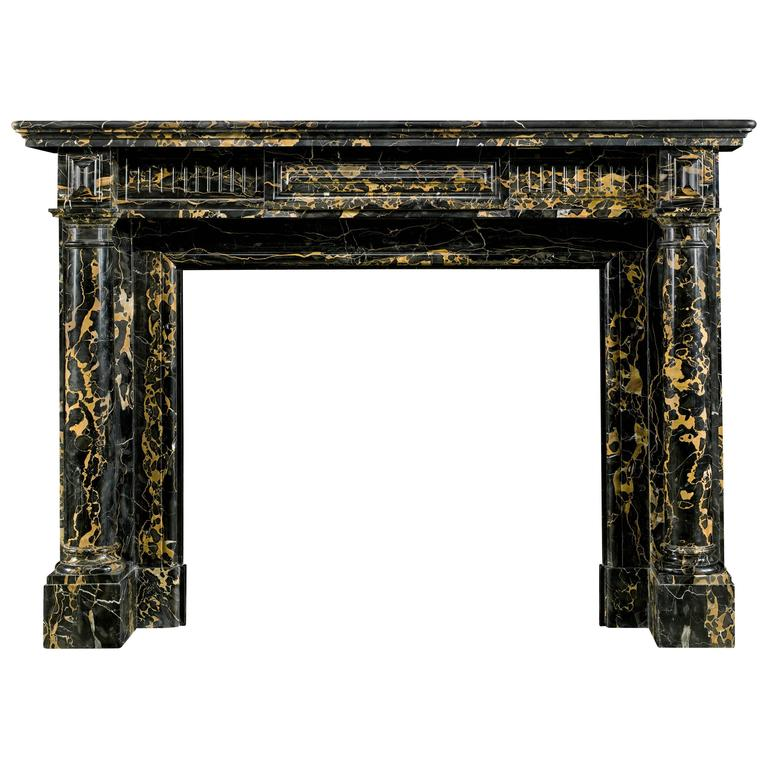 For Sale on 1stdibs - A most attractive French Regency columned antique fireplace surround in very fine black and gold veined Italian Portoro Marble. The moulded shelf is set