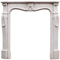 Petite French Louis XV Statuary Marble Fireplace