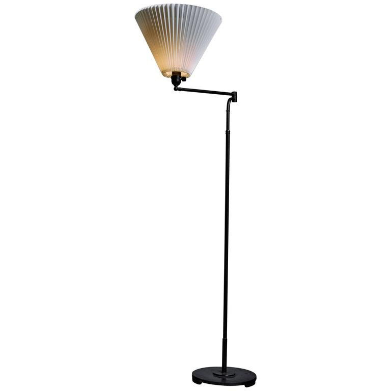 Metal floor lamp with swiveling and height adjustable stem for Floor lamp glass stem