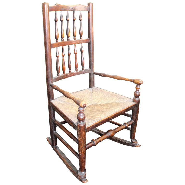 Antique Elm Spindle Back Childs Rocking Chair With Rushed