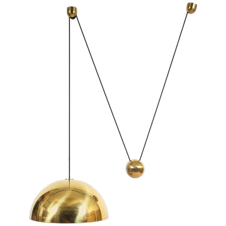 large florian schulz counterweight brass pendant at