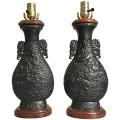 Pair of Hollywood Regency Chinese Ceramic Dragon and Phoenix Lamps