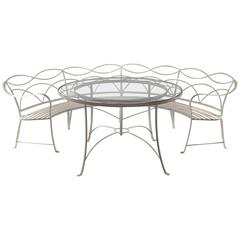 Rare Regency Style Wrought Iron Garden Table and Circular Bench, circa 1935
