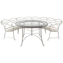 Rare Regency Style Wrought Iron Garden Table and Circular Bench, circa 1935