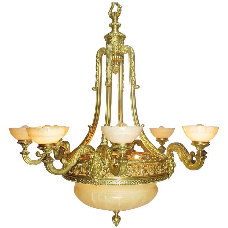 French Art Deco Gilt Bronze and Veined Alabaster Eight-Light Figural Chandelier