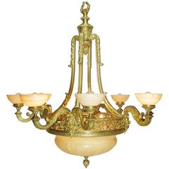 French Art Deco Gilt Bronze and Veined Alabaster Eight-Light Figural Chandelier