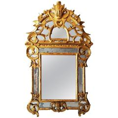 Spectacular French Regence Period Carved Giltwood Mirror, France, circa 1730