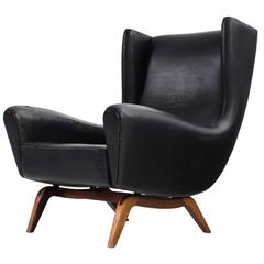 Illum Wikkelsø '110' Lounge Chair in Black Leather and Rosewood