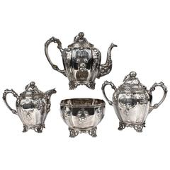 19th Century Four-Piece Wood and Hughes Repousse New York Coin Silver Tea Set