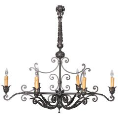 Long Mid-20th Century French Six-Light Iron Chandelier with Ornate Top
