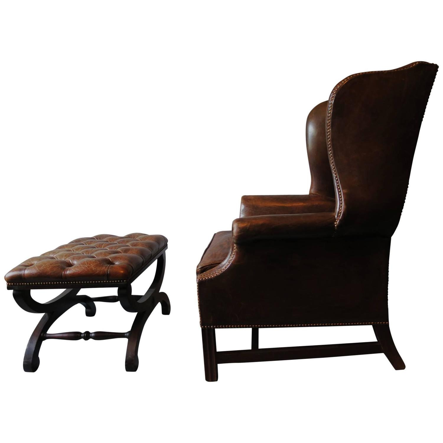 Dark brown leather chesterfield wingback armchair with for Leather wingback recliner sale