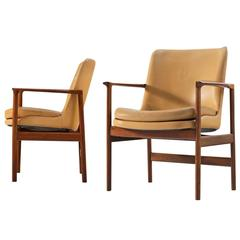 Ib Kofod-Larsen Set of Two Armchairs in Rosewood and Natural Leather
