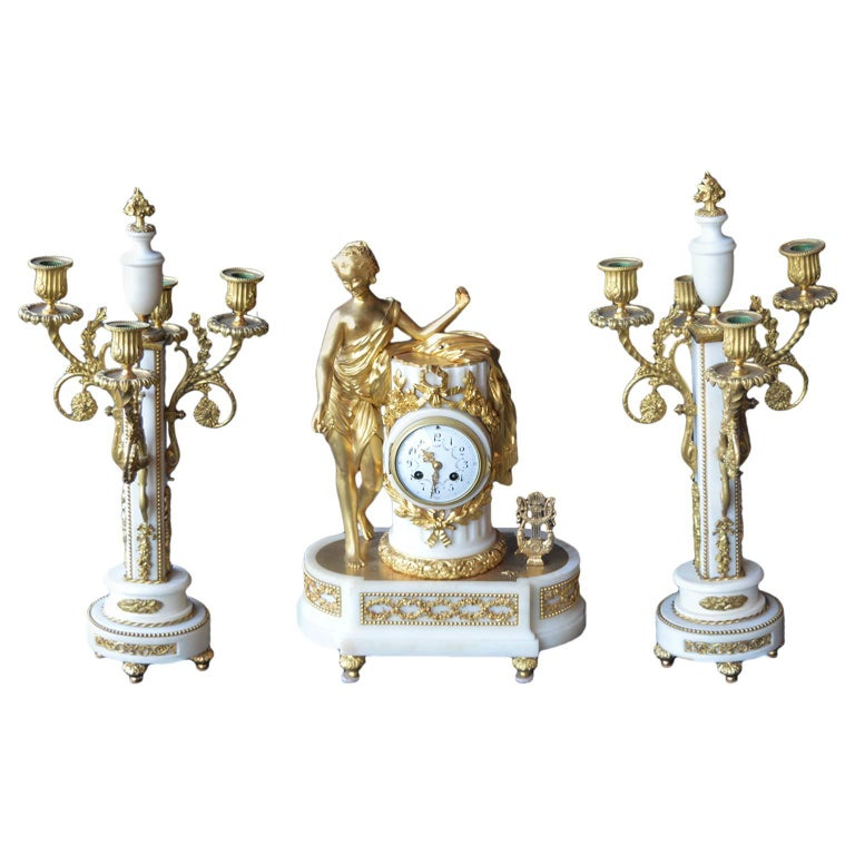 French Marble and Gilded Bronze Clock Set For Sale