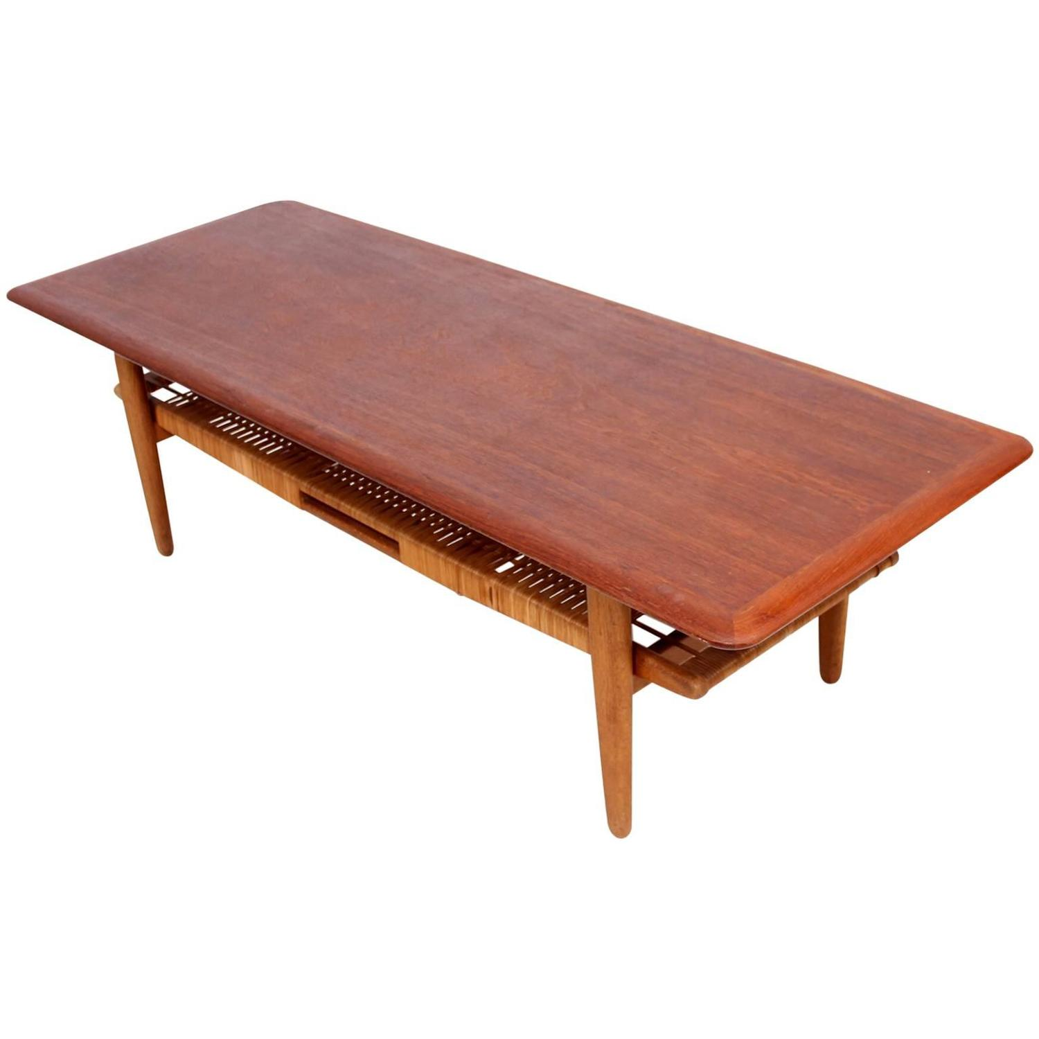 Danish modern teak coffee table cane shelve for sale at 1stdibs Modern teak coffee table