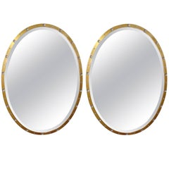 Pair of Oval Crystal and Gold Mirrors