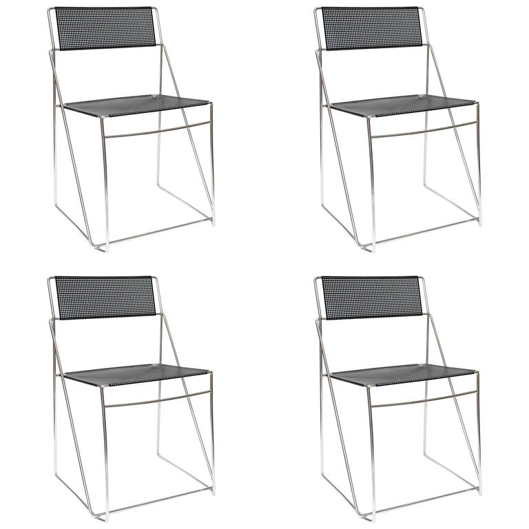 Set Of Four Italian Black Metal And Chrome Stacking Chairs For