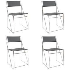 Set of Four Italian Black Metal and Chrome Stacking Chairs