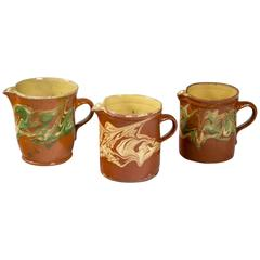 Collection of Three 'Jaspe' Pottery Pitchers, France, Late 19th Century