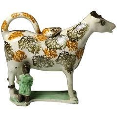 Antique Pearlware Pottery Figure of a Cow Creamer with Hobbled Legs