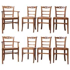 Set of Eight French Provincial Carved Rush Seat Dining Chairs