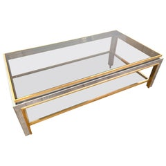 A Jean Charles 1970s polished chrome and brass Coffee Table with smoked glass
