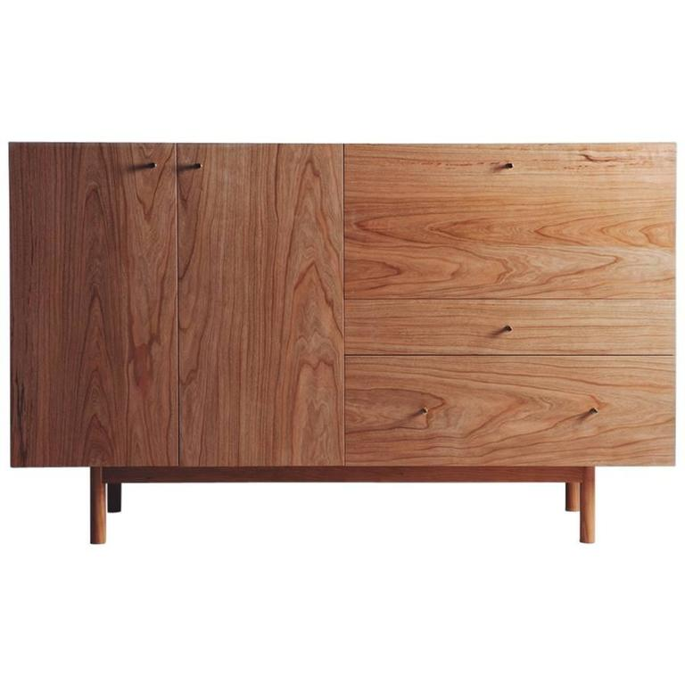 Rex sideboard in cherry wood with hand spun gold pulls and
