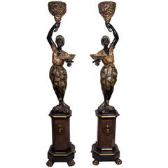 Pair of Venetian Polychrome Decorated and Ebonized Blackamoor Figures