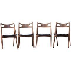 Four Hans Wegner CH29 Sawbuck Chairs