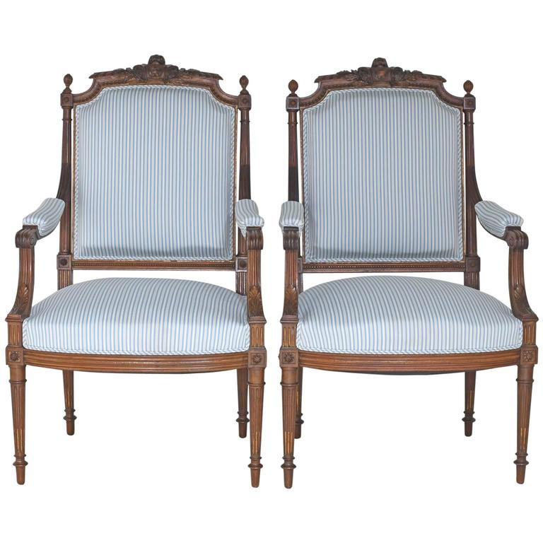 Pair of Antique French Upholstered Louis XVI Style Armchairs in Carved Walnut