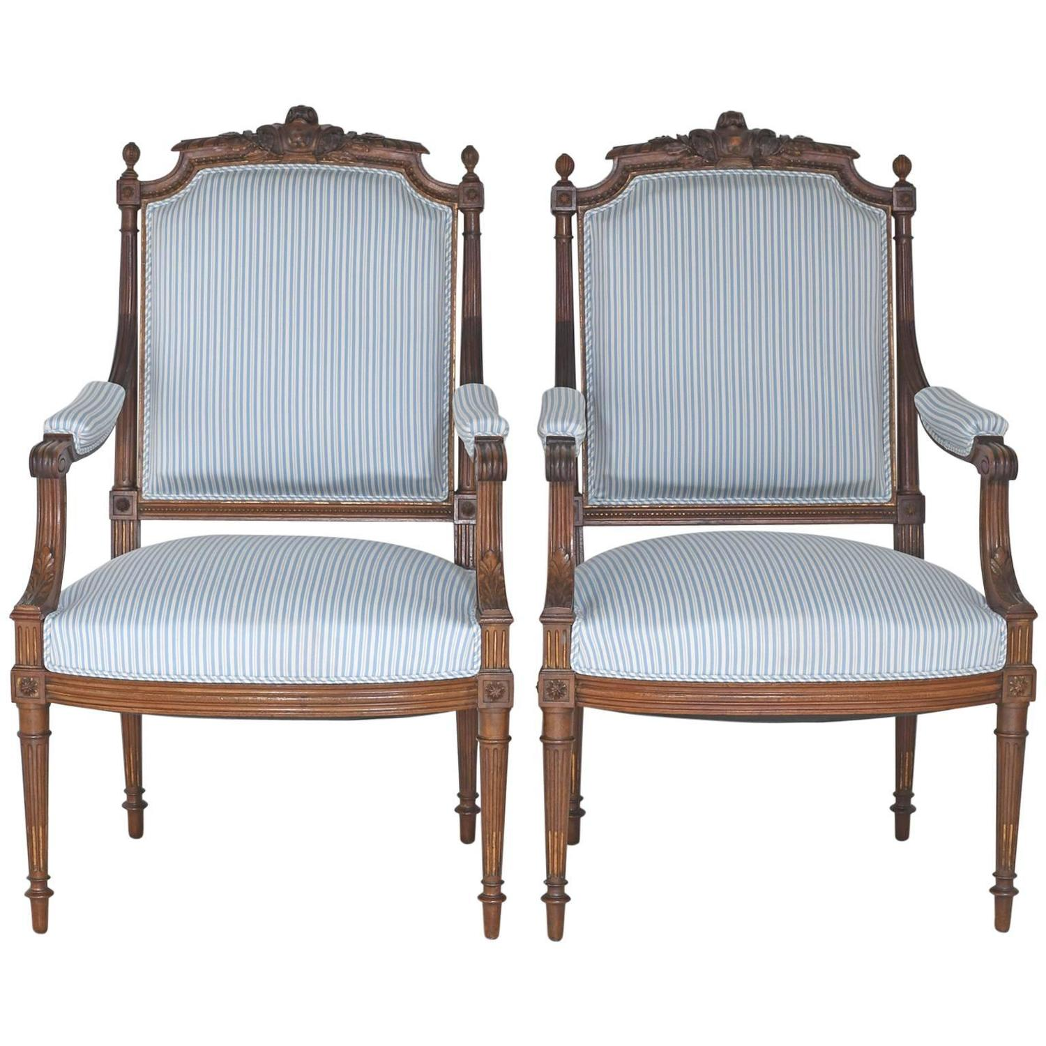 Pair of antique french upholstered louis xvi style armchairs in carved walnut at 1stdibs