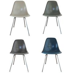 Four Herman Miller Eames DSX Dining Chairs