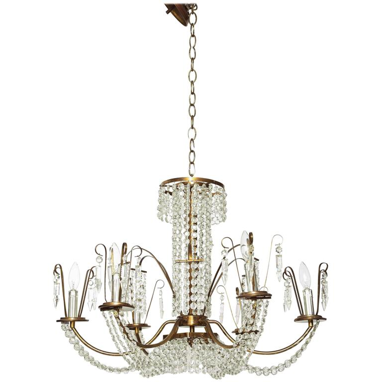 Hollywood Regency Six-Light Crystal and Antique Brass Chandelier