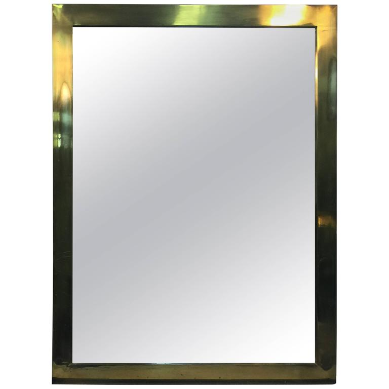 substantial brass wall mirror in the manner of karl springer