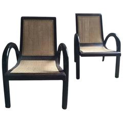 Pair of Ebony and Caned Low Armchairs
