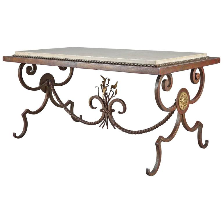Wrought iron and marble coffee table in the style of for Marble and wrought iron coffee table