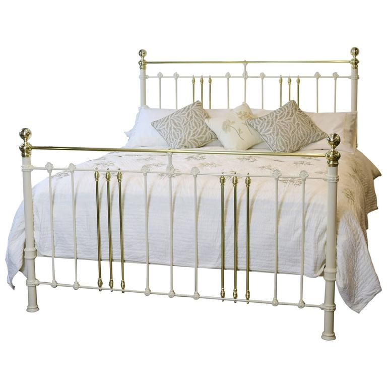 wide brass and iron bed in cream