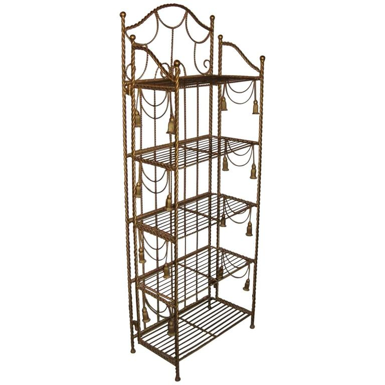 hollywood regency style brass tastle form five shelf etagere for sale at 1stdibs. Black Bedroom Furniture Sets. Home Design Ideas
