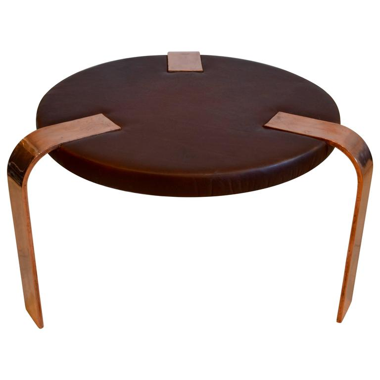 Round Art Deco Leather and Copper Leg Ottoman or Coffee Table by Donald Deskey