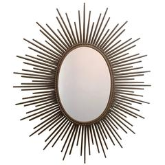 Gilt Sunburst Oval Mirror by Chaty in Vallauris, France, Signed