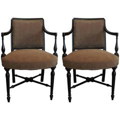 Pair of Edwardian Ebonized Upholstered Arm Chairs