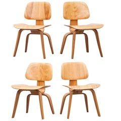 Set of Four Charles and Ray Eames DCW Chairs