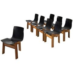Angelo Mangiarotti Set of Eight Chairs in Patinated Black Leather