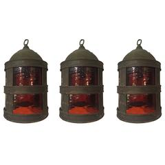 Set of Three Arts & Crafts Tole and Amber Glass Lanterns