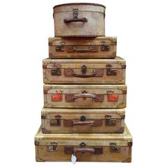 Set of Vellum Pieces of Luggage, Five Vellum Suitcases and One Round Hat Box