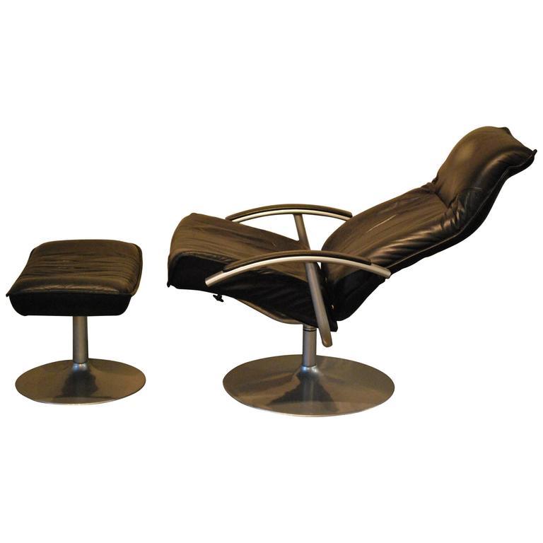 Mid Century Modern Black Leather Chrome Lounge Chair with Ottoman circa 1960